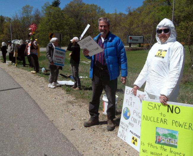 Protestors gather outside the entrance to the Palisades plant on Monday.