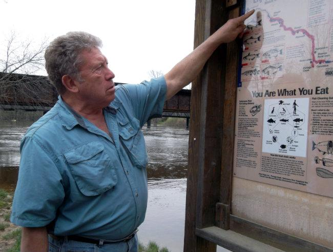 Ron Clark traces the sturgeon's spawning route up the Kalamazoo River. Sturgeon used to swim to near Albion to spawn, but dams block that path.