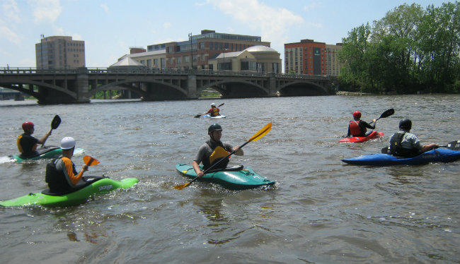 Kayakers can't go too far in the Grand River in downtown Grand Rapids because the dams are dangerous.