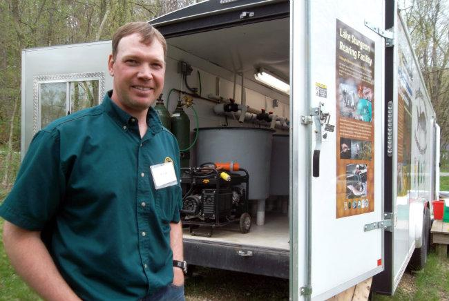 MDNR biologist Kregg Smith shows people around the mobile rearing facility in New Richmond.