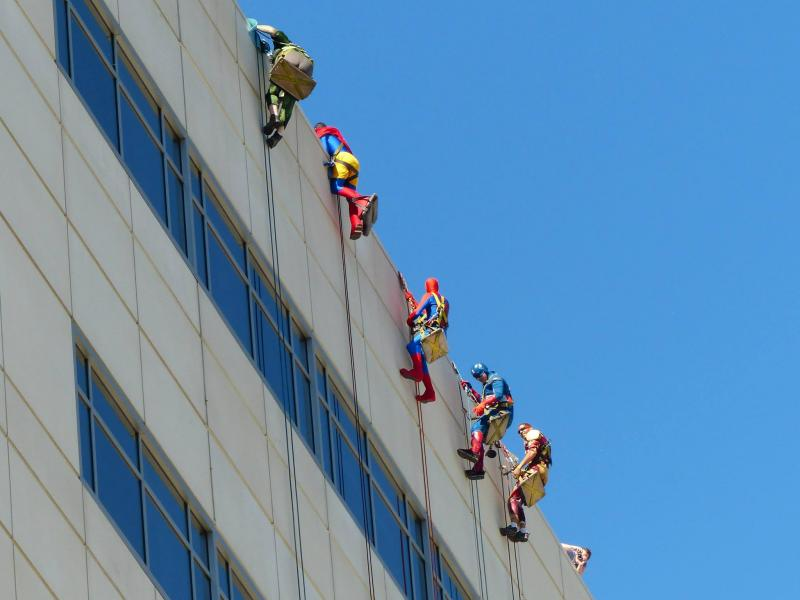 Superheros wash windows at Mott's