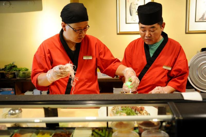 Two chefs at Miki preparing dishes for Restaurant Week in 2012