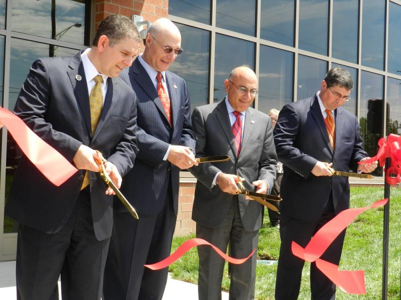 Lansing Mayor Virg Bernero (left) joined Emergent Biosolutions Executive Chairman of the Board Fuad El-Hibri and President Daniel Abdun Nabi in cutting the ribbon