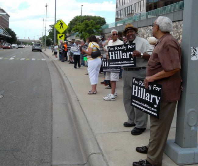 Hillary Clinton supporters rally in Grand Rapids. Clinton spoke at a dinner that was closed to the press Monday night.