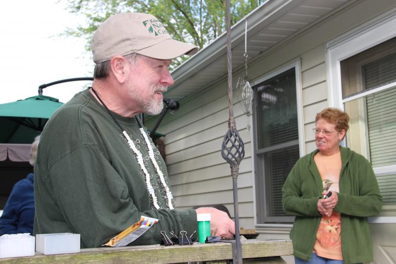 Hummingbird bander Rich Keith and homeowner Mary Bird.