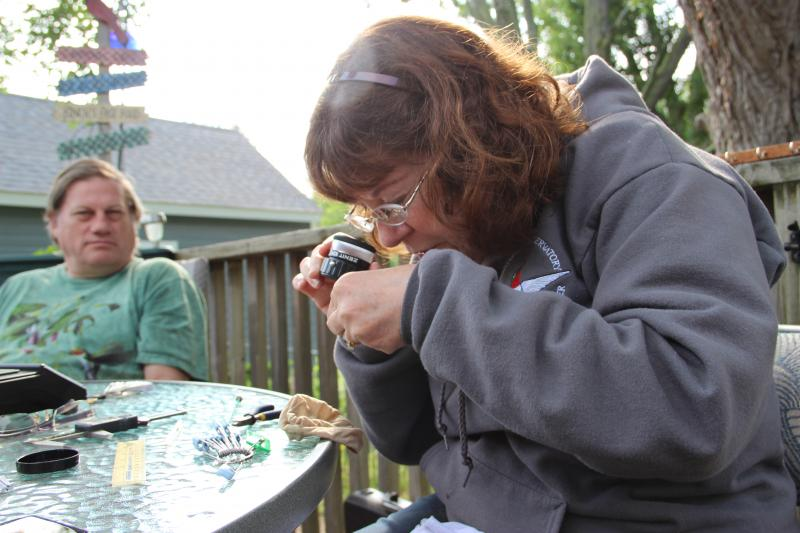 Brenda Keith examines a bird's bill.