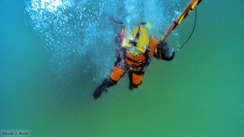 Commercial diver descending to wreck site.