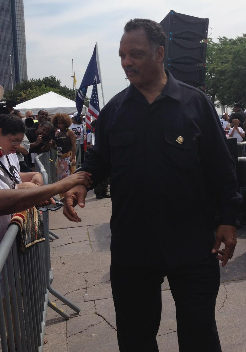 Rev. Jesse Jackson greets supporters at the end of the march on June 22.