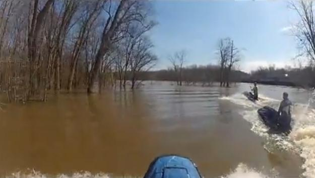Jetskiiers on the flooded Grand River this past April.