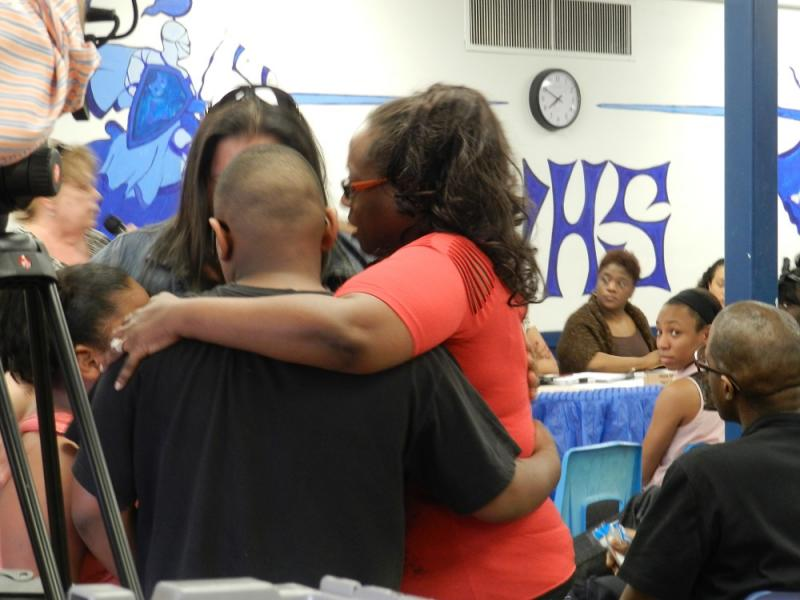 Students and parents of the Buena Vista school district embrace during a school board meeting earlier this year
