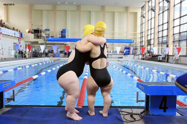 Australian athletes Samantha Lily (R) and Erica Peter hug during the swimming competition at the World Dwarf Games in Larne Leisure centre, twenty miles north of Belfast, July 28,2009.