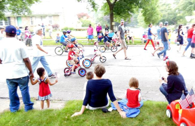 A couple hundred kids rode bikes decked out in red white and blue in the parade.