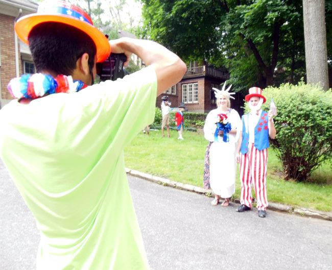 Every year, two young adults are chosen to play Uncle Sam and Lady Liberty in the parade.
