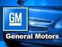 General Motors logo in front of General Motors car