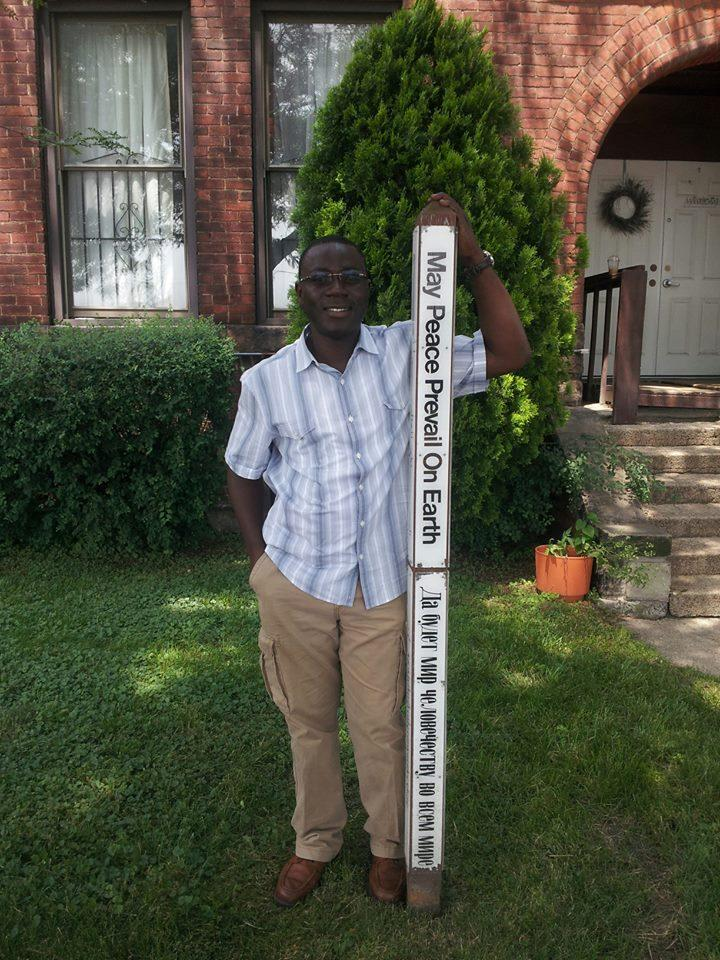 Koffi Itito in front of the Freedom House in Detroit.