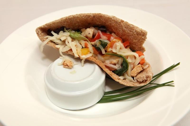 "Jacob Hirsch's ""picky eater pita pizza pocket"" recipe was one of the 54 winners in the Kids' State Dinner 2013 competition."