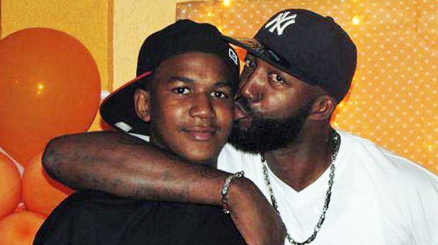 "Trayvon Martin (left) seen here with his father, Tracy, who tweeted after the not guilty verdict """"Even though I am broken hearted my faith is unshattered I WILL ALWAYS LOVE MY BABY TRAY"""