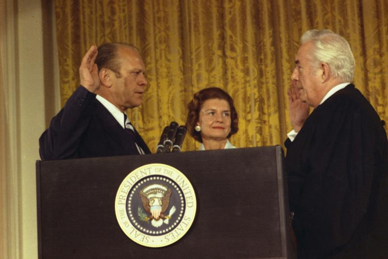 Gerald R. Ford is sworn in as the 38th President of the United States by Supreme Court Chief Justice Warren Burger, in the East Room of the White House, August 9, 1974.