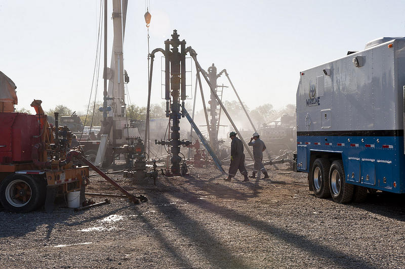 Drilling in a well to release natural gas.