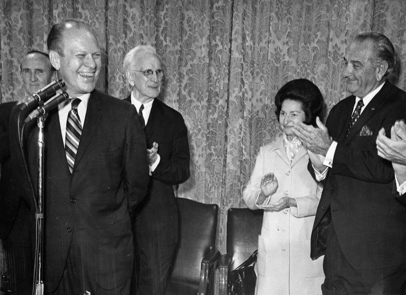 President and Mrs. Lyndon B. Johnson, Senate Majority Leader Mike Mansfield (MT), Speaker of the House John McCormack and others salute House Minority Leader Gerald R. Ford, 1967.