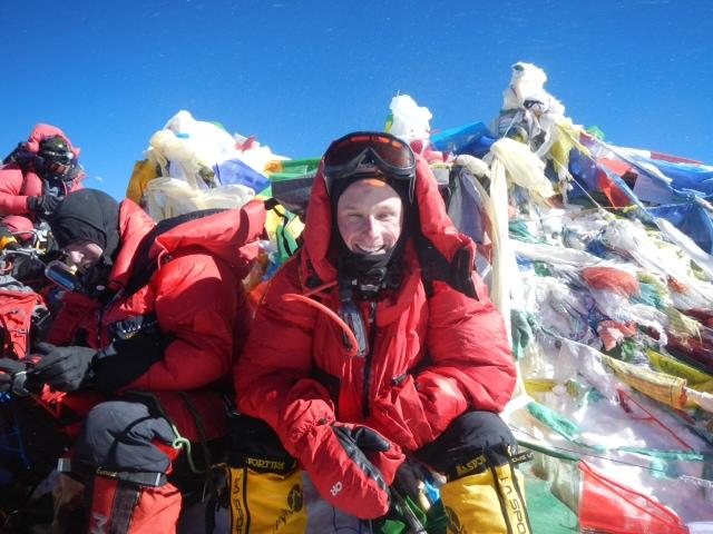 Scott DeRue at the summit of Mount Everest.