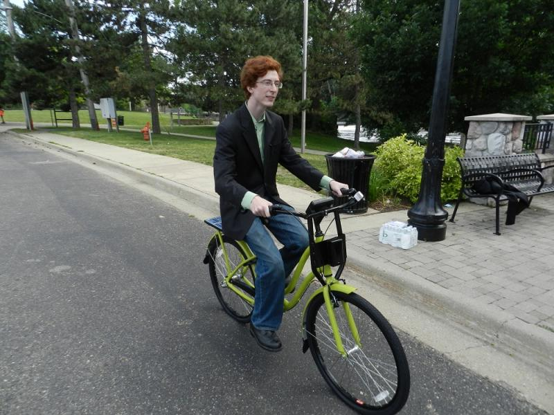 A2B's Carl Vitulo rides the company's prototype bike in Lansing