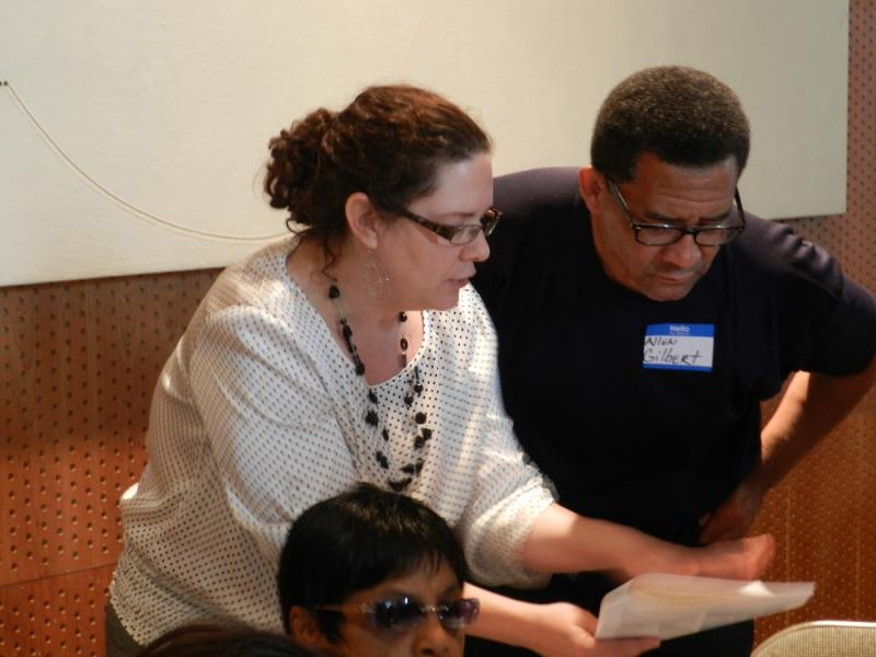 Flint Chief Planner Megan Hunter (left) speaks with one of the facilitators during this week's master plan meeting