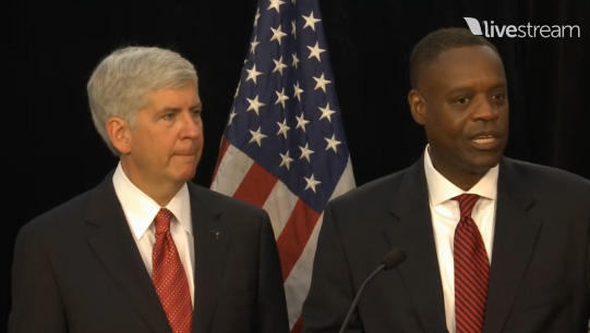 Michigan Gov. Snyder (left) and Detroit Emergency Manager Kevyn Orr discuss the bankruptcy filing with the press Friday morning.