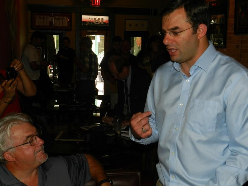 Rep. Justin Amash (R-Michigan) talks with constituents in a Battle Creek coffee shop about the potential for U.S. military action against Syria