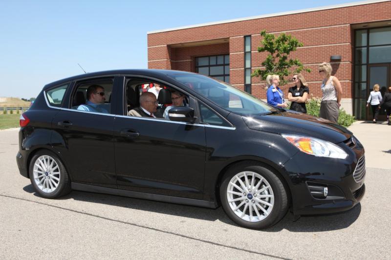 U.S. Representative John D. Dingell rides in a Ford C-MAX Energi Plug-in hybrid.
