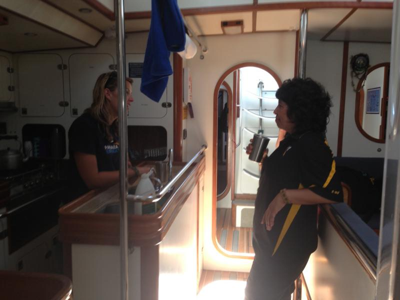 Asta Mail and Lorena Rios-Mendoza talk plastics in the cabin of the Sea Dragon.