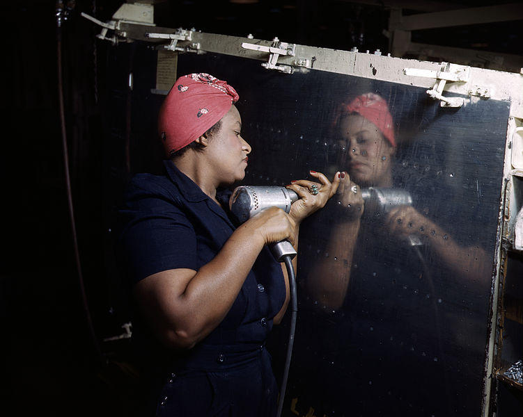 A real-life 'Rosie the Riveter' in 1943. She worked at Vultee-Nashville, Tennessee. The plane is an A-31 Vengeance dive bomber.