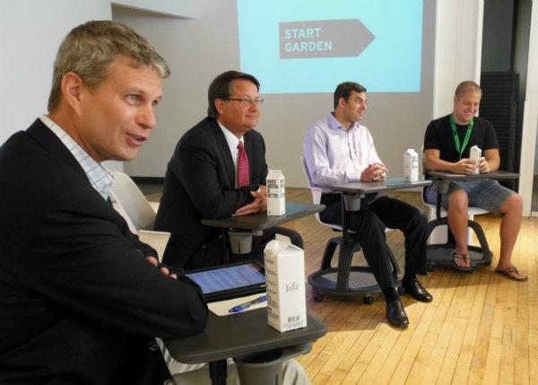 Congressmen Bill Huizenga, Gary Peters and Justin Amash listen to entrepreneurs at Start Garden in Grand Rapids Thursday afternoon.