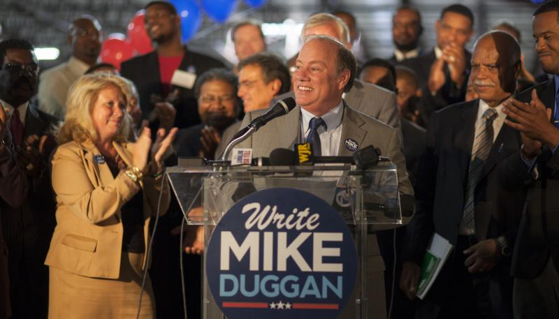 Center, Detroit's Mayor-elect Mike Duggan