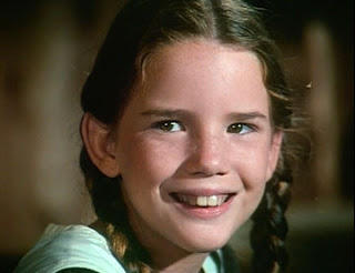 "A younger Melissa Gilbert playing Laura Ingalls Wilder on ""Little House in the Prairie."""