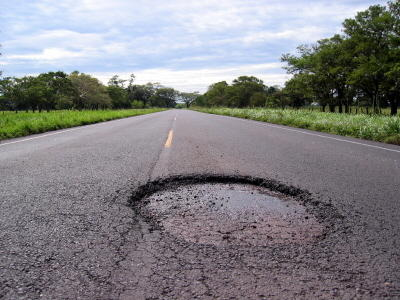 Pothole in a road.