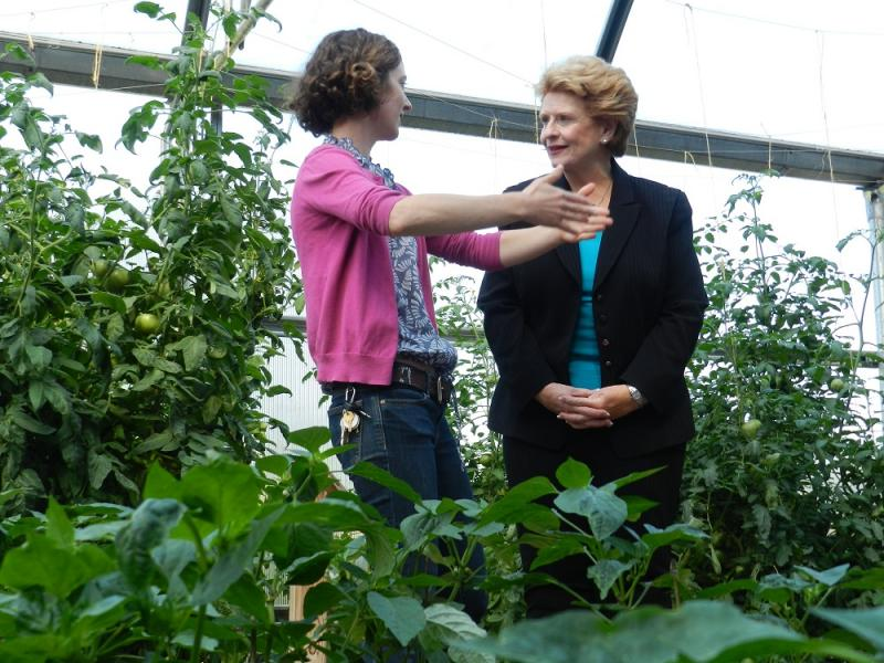 Rita O'Brien (left), the director of Lansing's Hunter Park garden house, gives U.S. Sen. Debbie Stabenow a tour of the facility