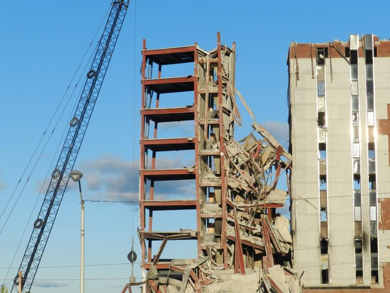 Thursday, demolition crews successfully pulled down half of an addition to the old Consumers Energy HQ, but the half that remained started leaning toward other buildings, which were evacuated.