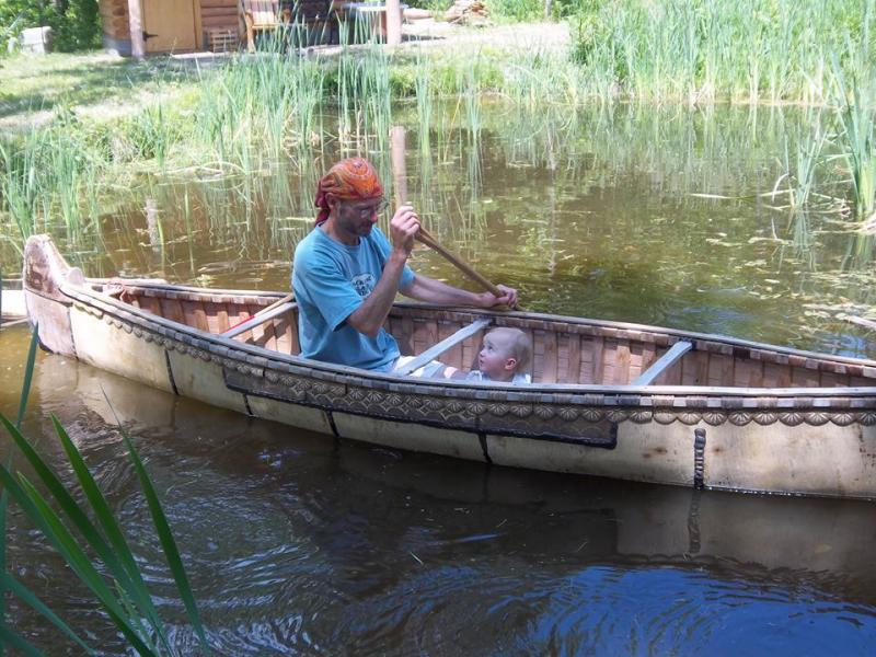 Miller and friend in his traditional birch bark canoe, he made himself
