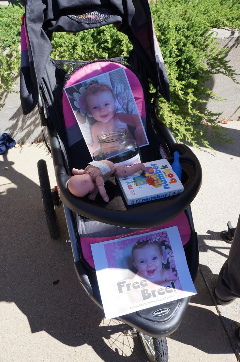 Bree Green's empty stroller at Tuesday's rally outside the state Department of Human Services offices in Lansing.""