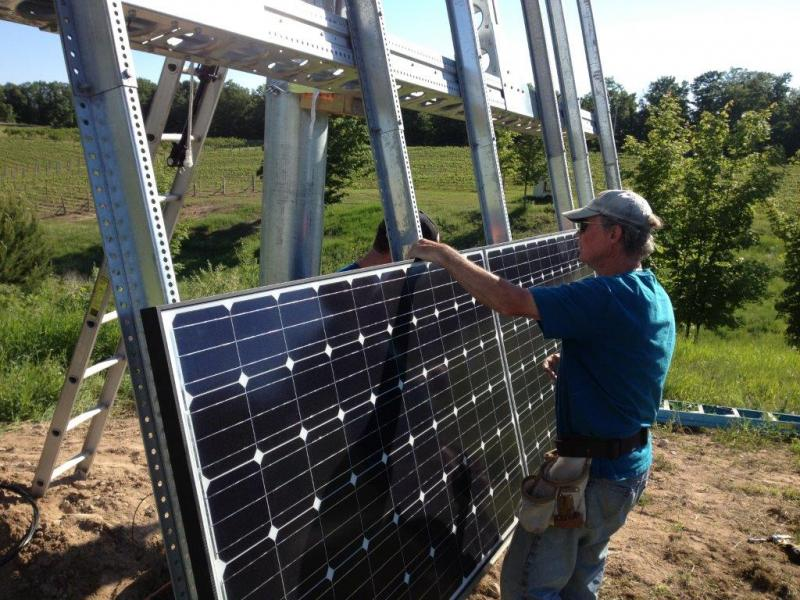 Installing the solar panels on the vineyard.