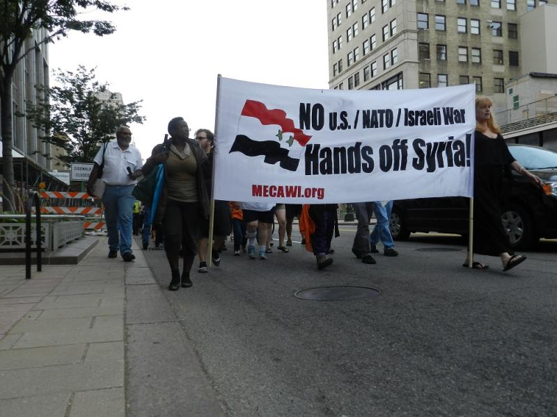 About a hundred anti-war protesters walked down Woodward Avenue in Detroit Sunday afternoon