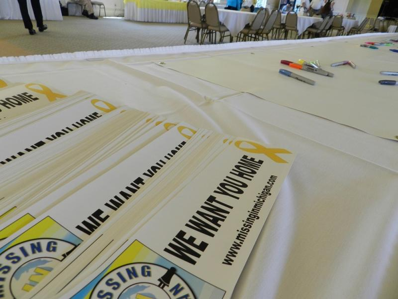 Bumper stickers on a table at the Missing in MIchigan conference in Bath