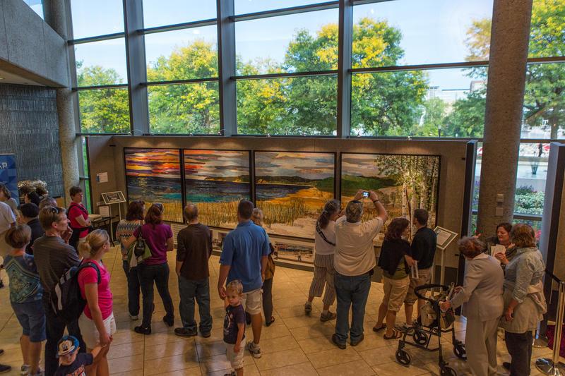 Ann Loveless from Frankfort, MI wins top prize, $200,000 for her landscape art quilt, Sleeping Bear Dune Lakeshore.