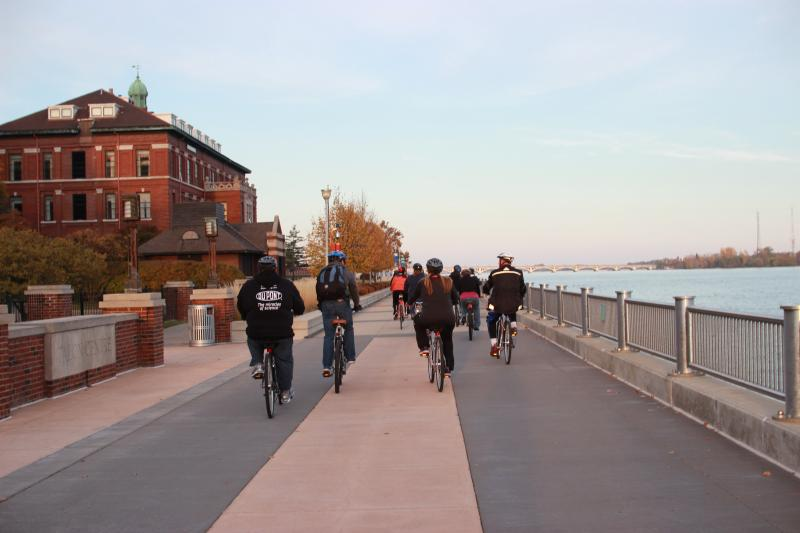 Riders on the tour near Detroit's riverfront.