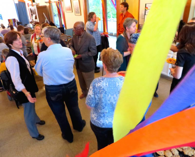 "People gather at a celebration for equality at a church. Some Christians say they love and support the gay community and denounce the ""mean-spirited and hateful words"" coming from other Christians."