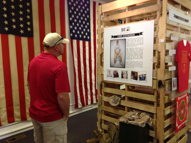An Artprize visitor looks at other veterans' displays