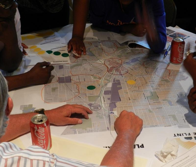 Flint residents pored over maps during a community meeting on the city's new master plan earlier this year.