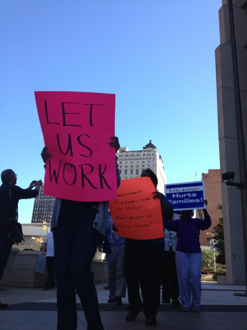 Federal workers protest the government shutdown outside the federal building in Detroit.