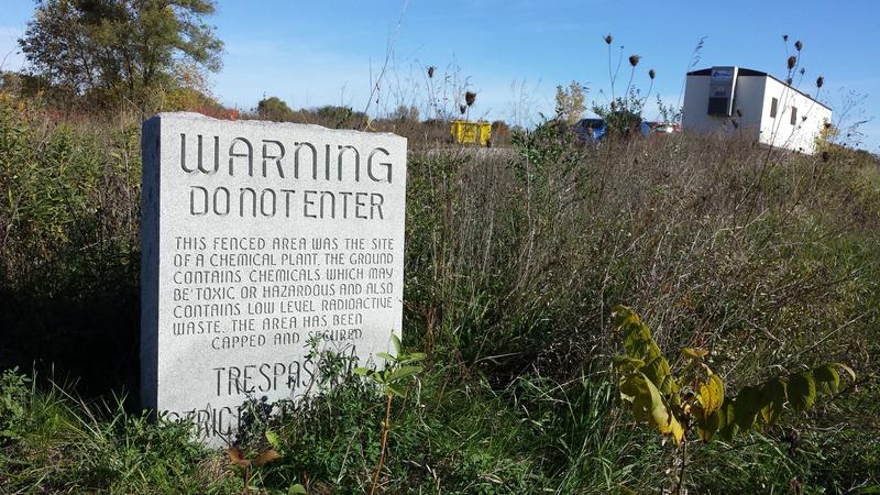 A granite marker was placed on the site of the former Velsicol Chemical Corp. plant site in St. Louis, Michigan warning people to stay away.